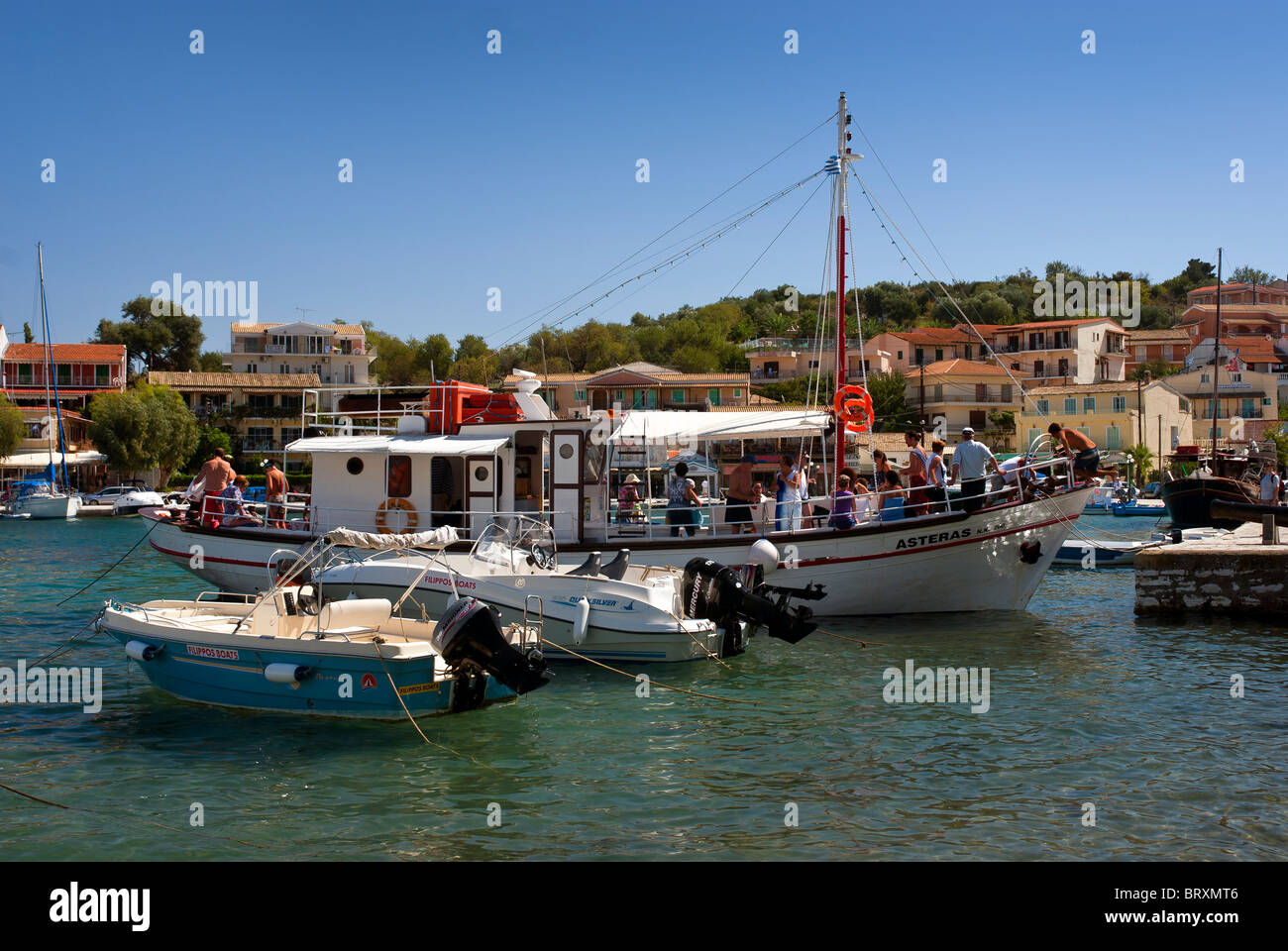 Tourist Boat in Kassiopi Harbour, Corfu, Ionian Islands Greece. Stock Photo