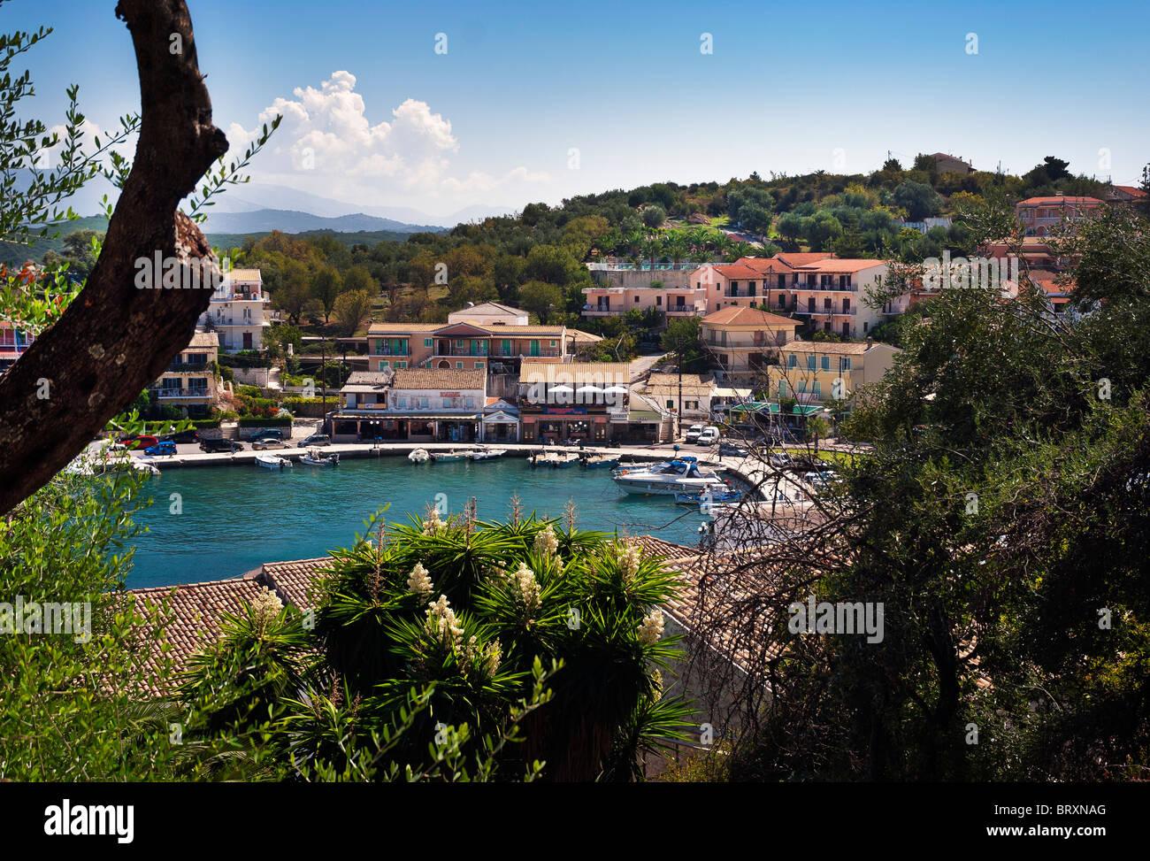 Kassiopi Village Bay Harbour, Corfu, Ionian Islands Greece. - Stock Image