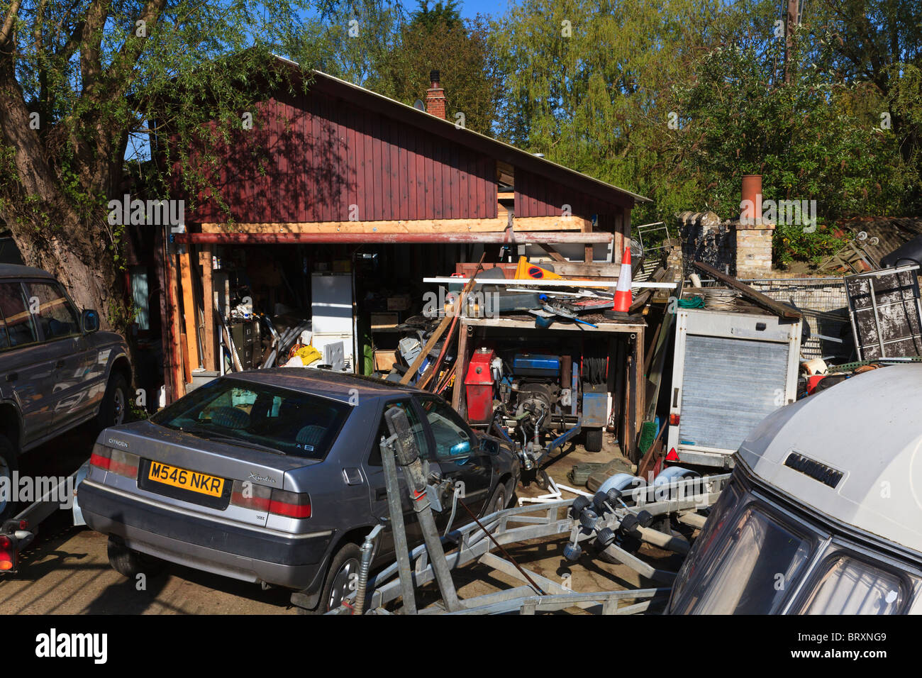 Builders Junk yard, containing cars, Caravan Shed Trailers, on the ...