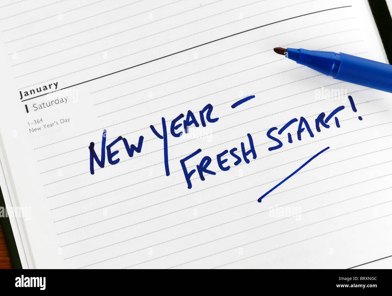 New Year resolution marked in a diary for 01 January - Stock Image