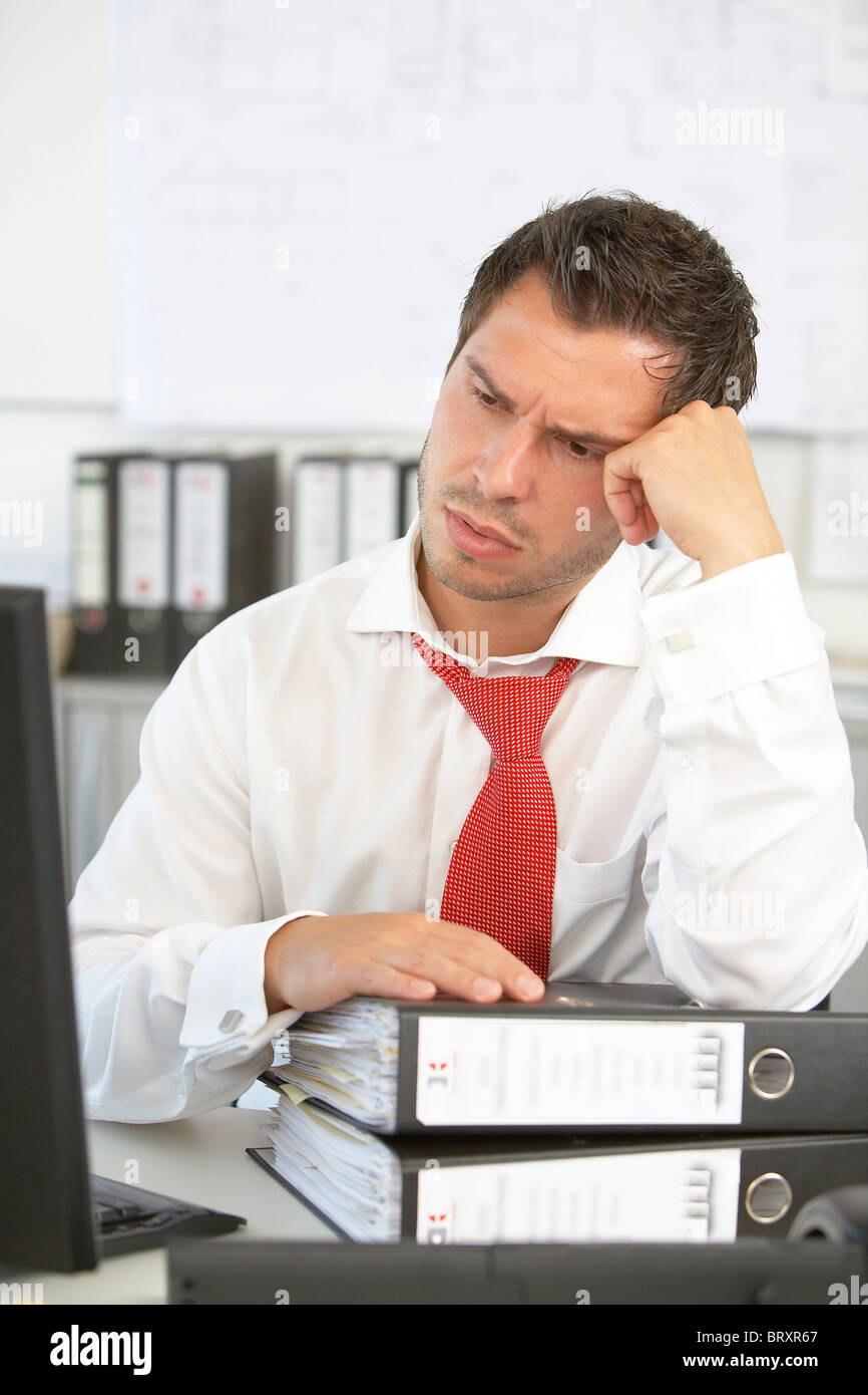 Thoughtful man in the office - Stock Image