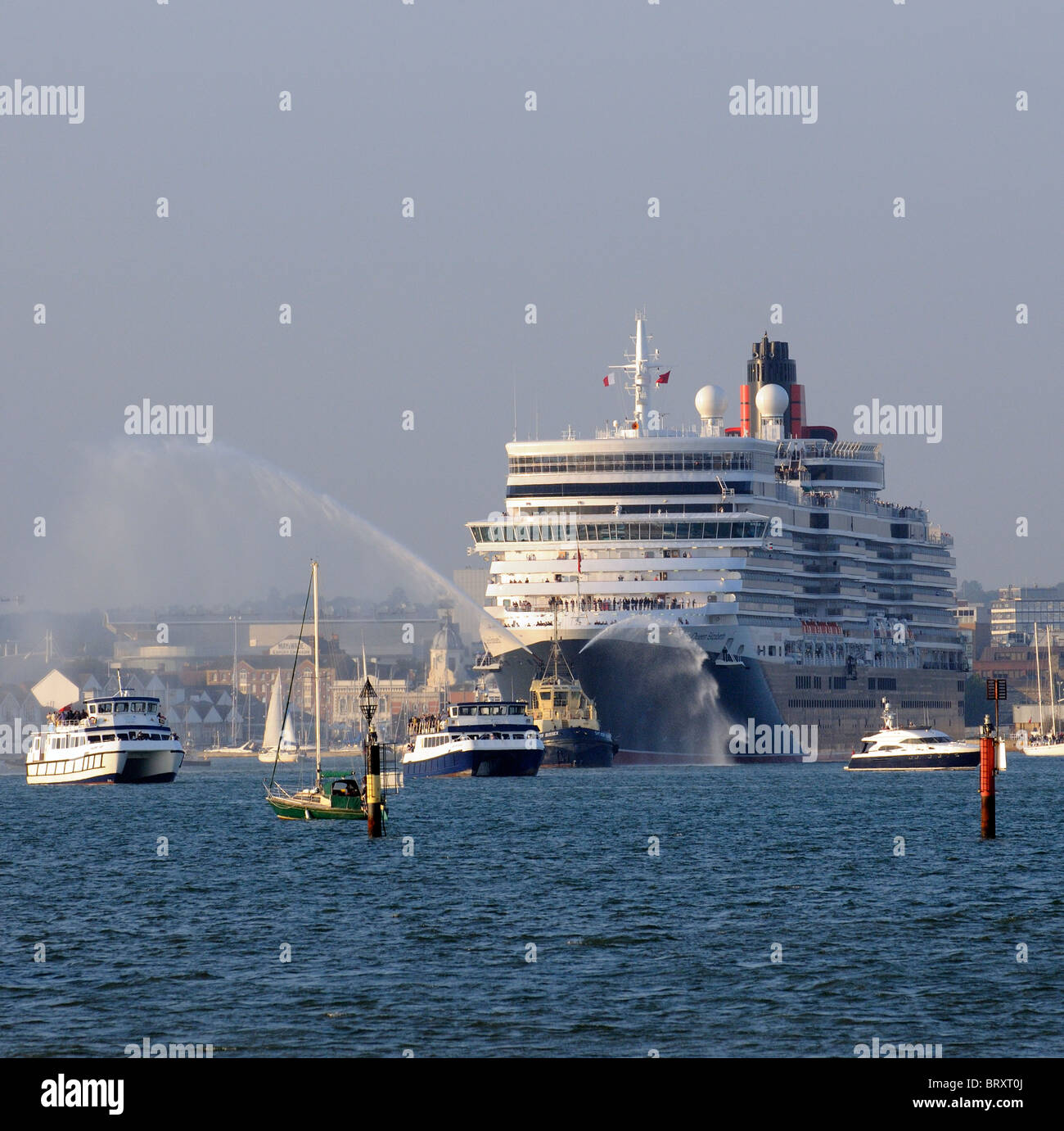 Cunard's new Queen Elizabeth cruise liner departing Southampton on her maiden voyage escorted by a flotilla - Stock Image