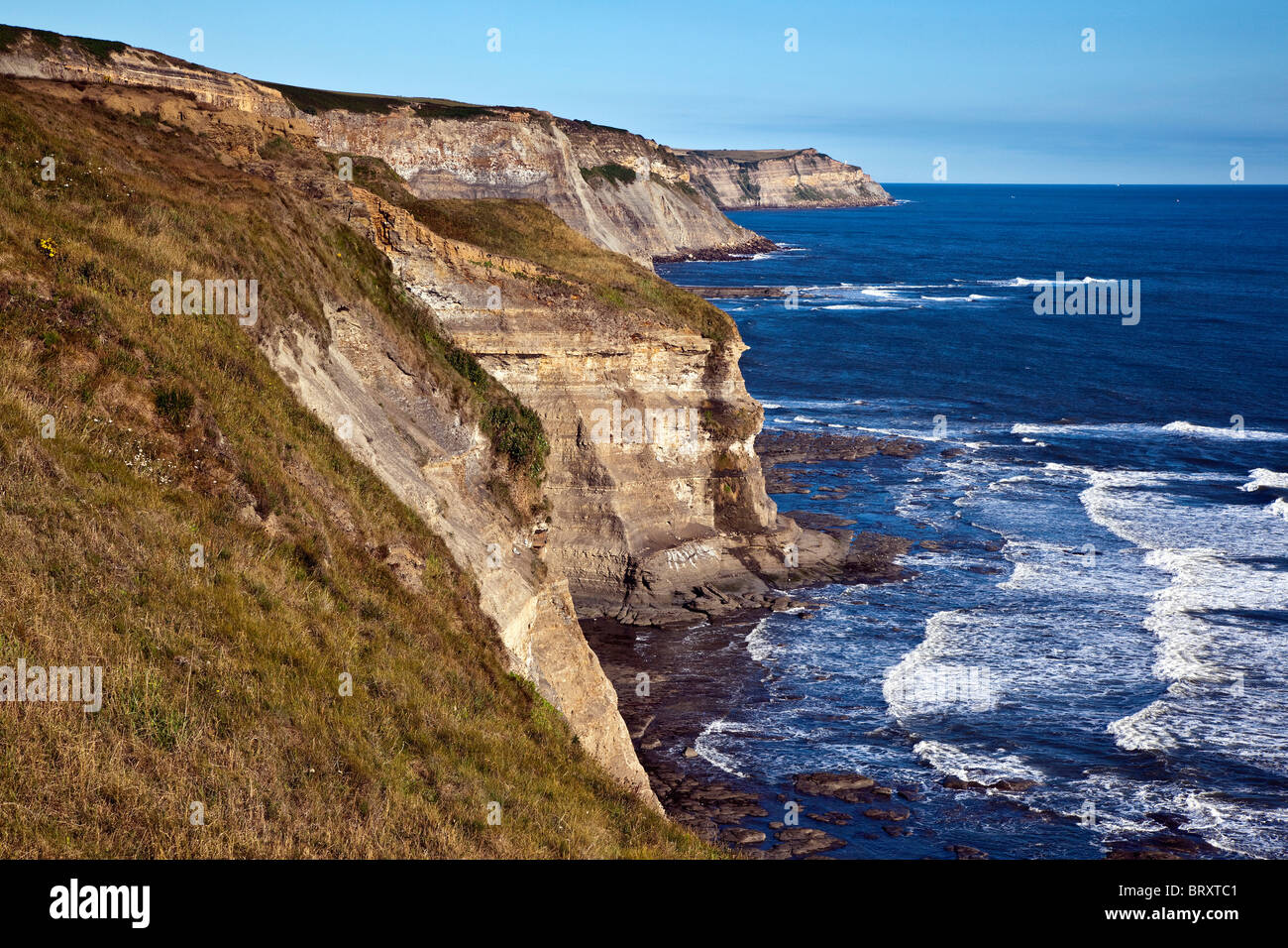 Steep cliffs on the Yorkshire Coast, North of Robin Hoods Bay, - Stock Image
