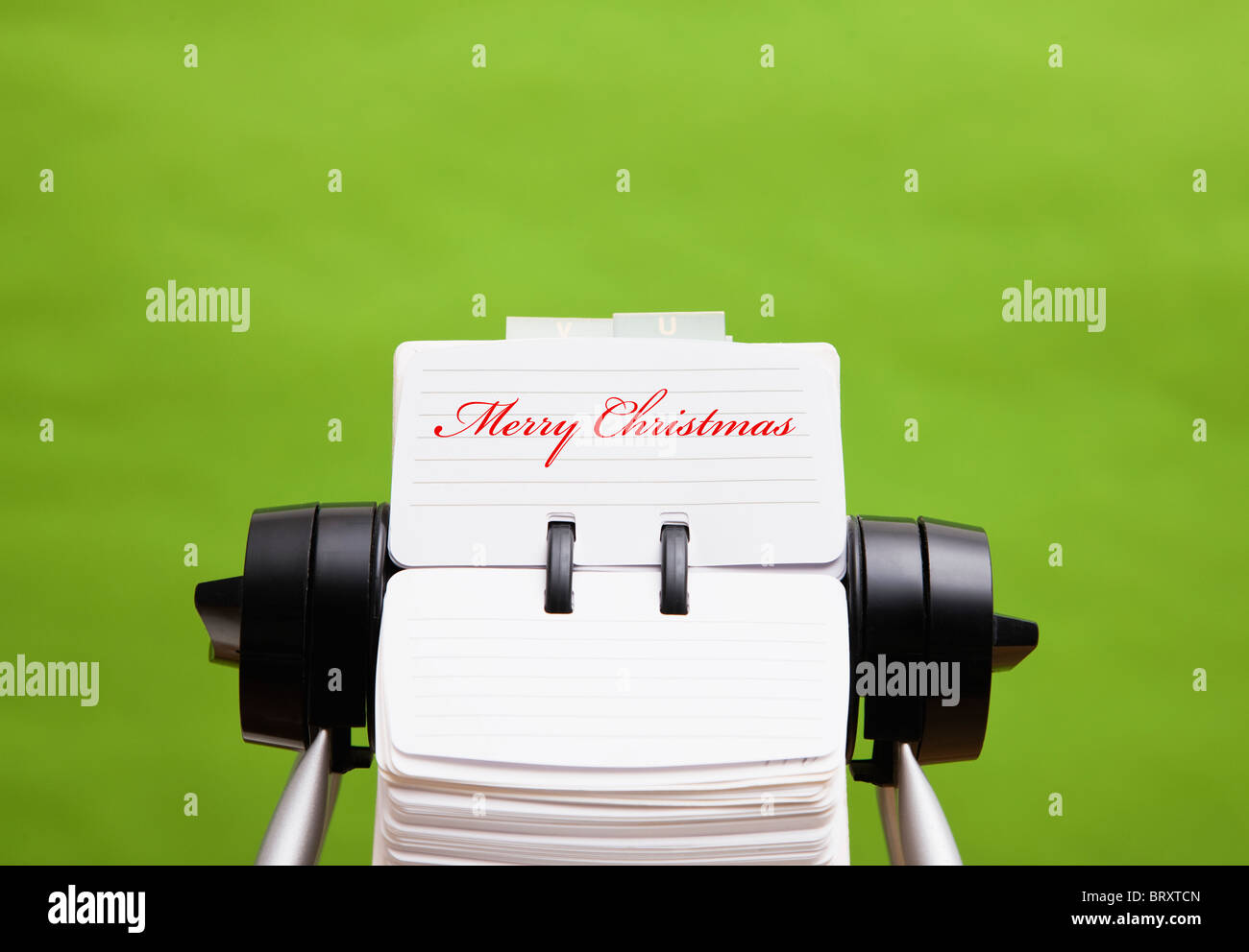 Rotary card file with merry Christmas card - Stock Image