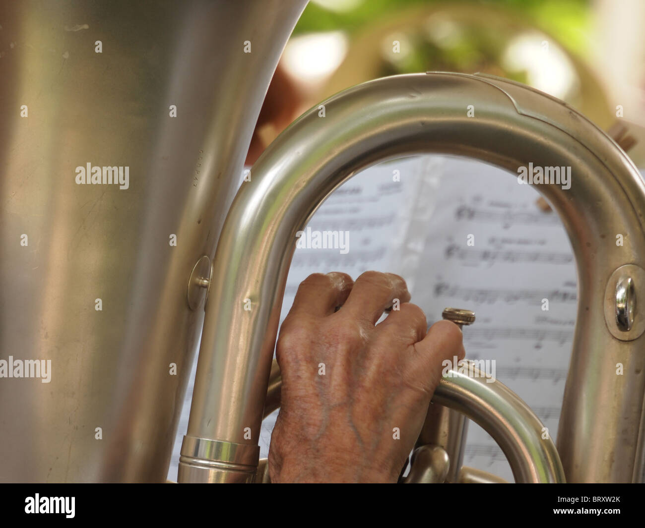 Detail of Tuba Player, Corsham Silver Band performing in Swindon Town Gardens, July 2010 Stock Photo