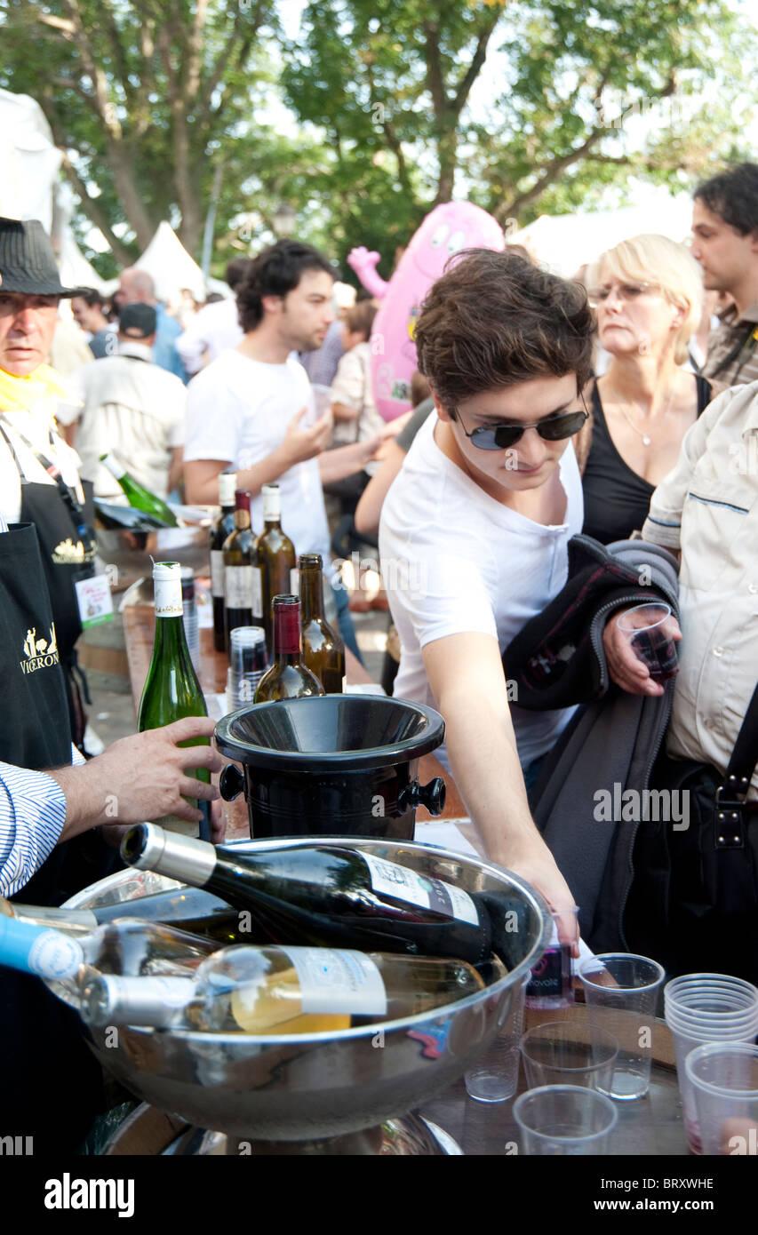 "people tasting wine at a stand in Paris, ""Fete des Vendanges"" , harvest fest Stock Photo"