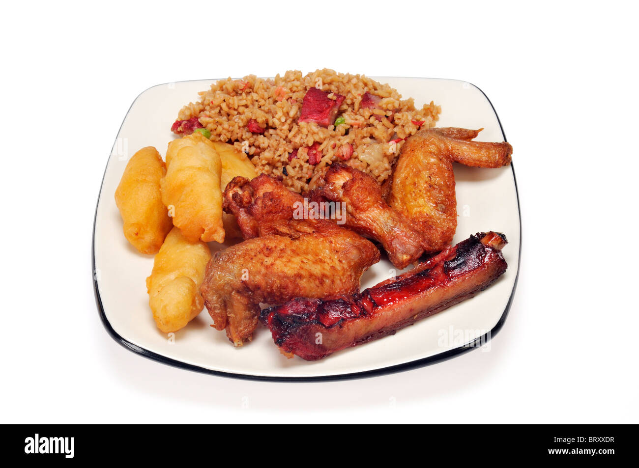 White dinner plate with a chinese food meal of pork fried rice chicken fingers chicken wings u0026 spare rib on white background.  sc 1 st  Alamy & White dinner plate with a chinese food meal of pork fried rice Stock ...