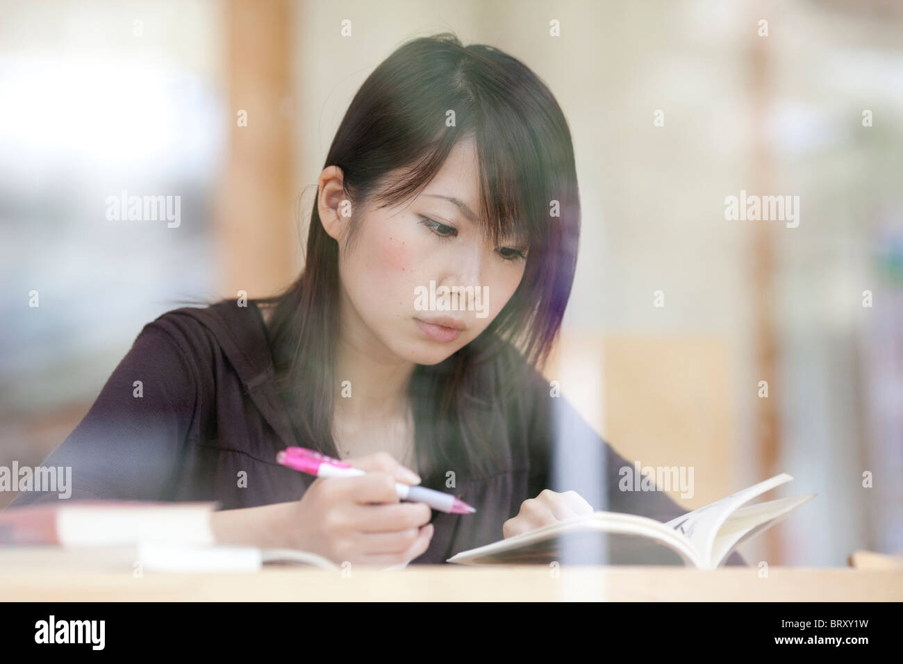 Young woman studying, Japan Stock Photo
