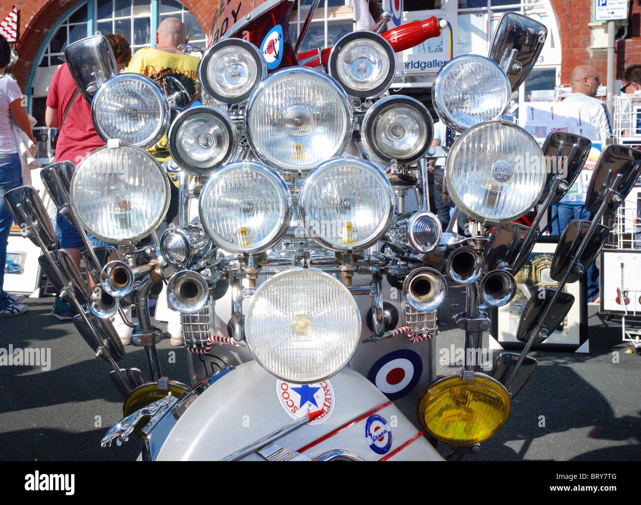 Mod moped decorated with many lights - Stock Image