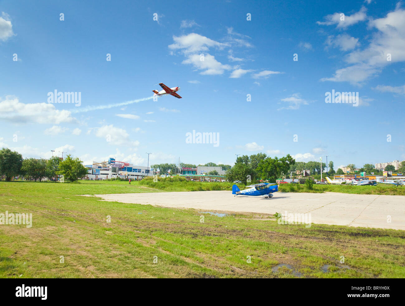 Air Show 2009 in Krakow. Blue RWD-5R on the runway - Stock Image