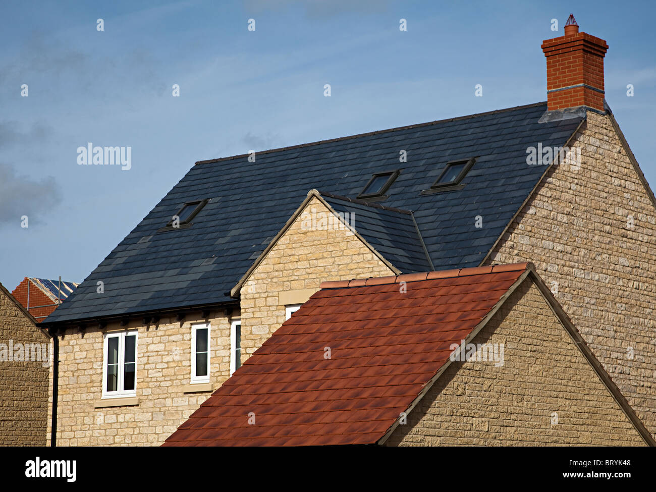 Roofs with different tile colours on new build houses Woodstock Oxfordshire England UK - Stock Image