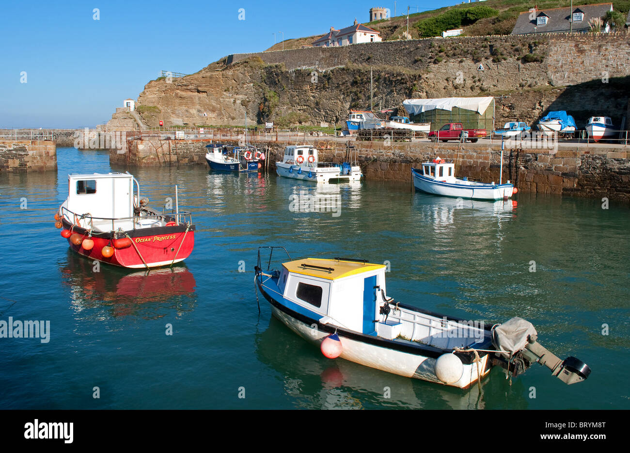 fishing boats in the harbour at portreath, cornwall, uk Stock Photo