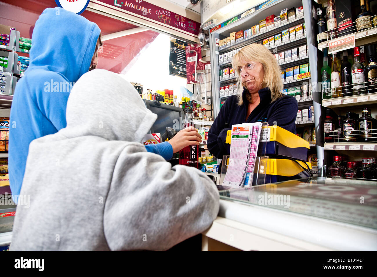 Children trying to buy alcohol in a convenience store - Stock Image