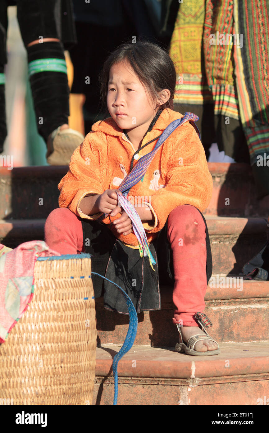 A Black hmong girl takes a break from selling to tourists, Sapa, Vietnam - Stock Image
