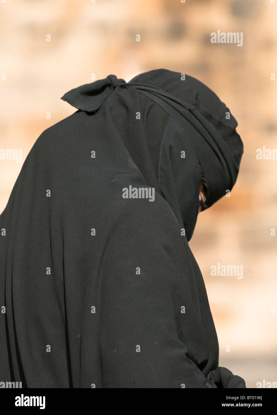 Muslim woman wearing the Burka on the street in Britain. - Stock Image