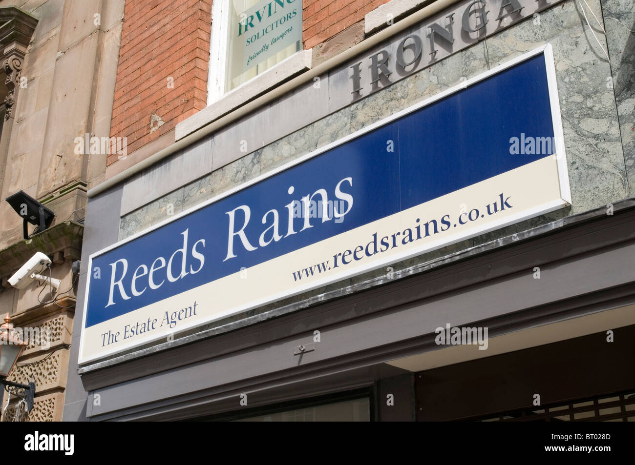 reed rains estate agents agent letting uk highstreet high street property market shop shop branch branches management - Stock Image