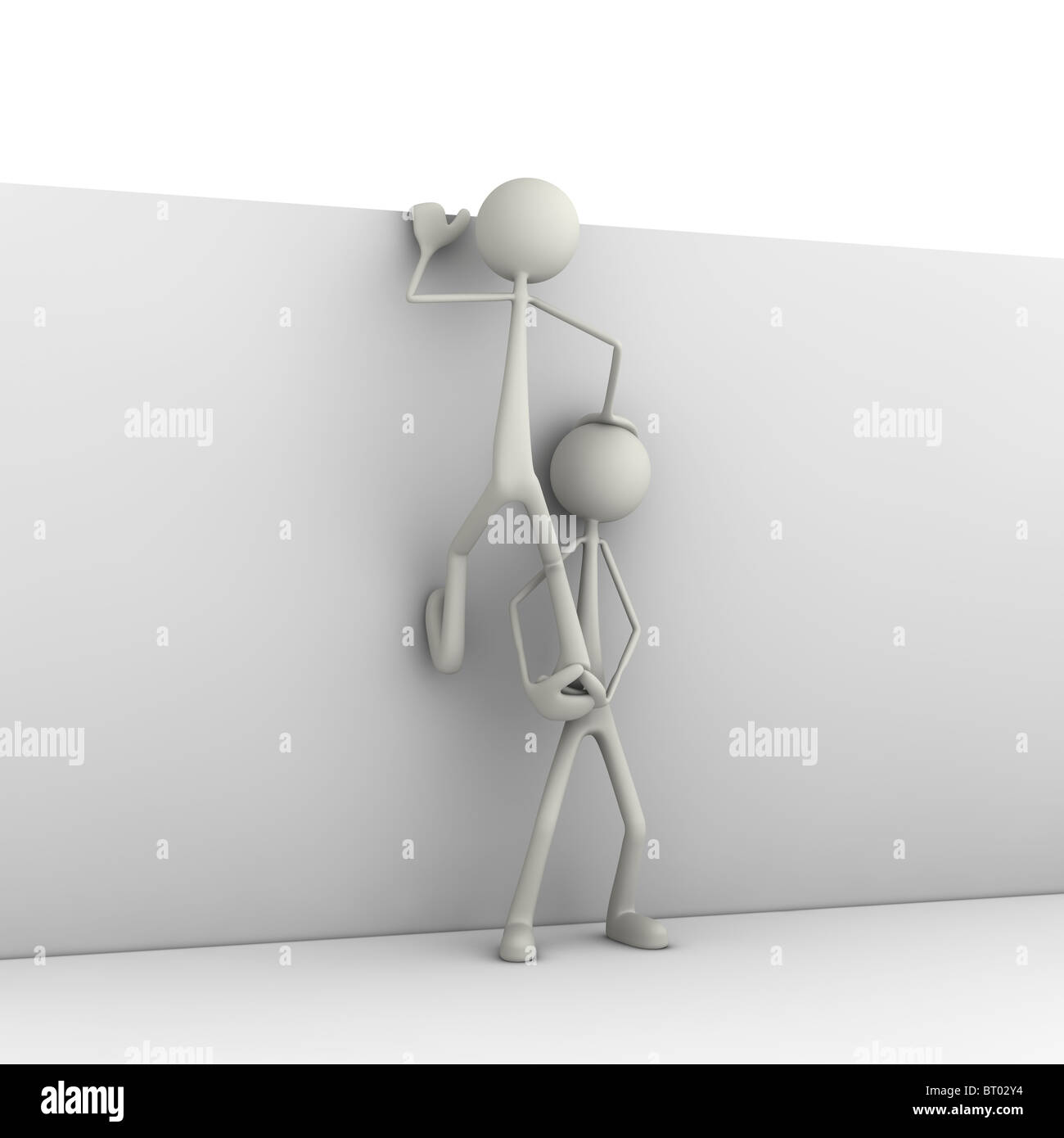 Figures climbing on wall - Stock Image