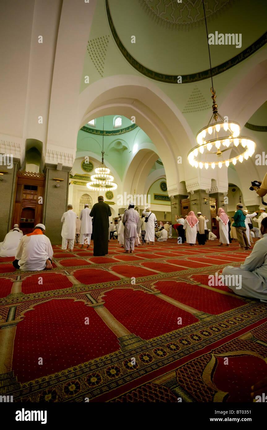 Muslims pray inside Masjid Quba April 21, 2010 in Medina, Saudi Arabia. - Stock Image