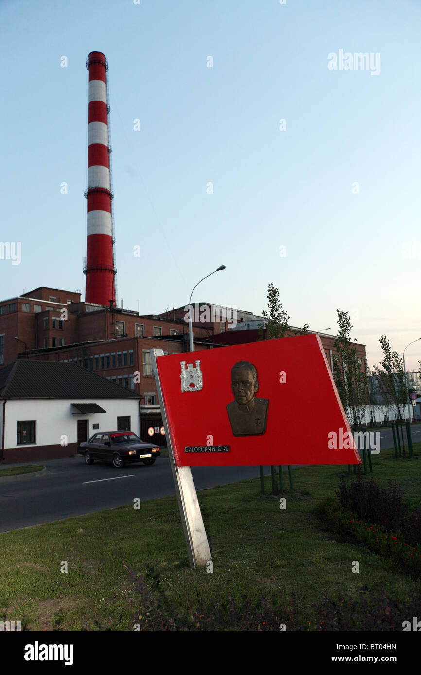 Red signboard with an image of a person, Brest, Belarus - Stock Image