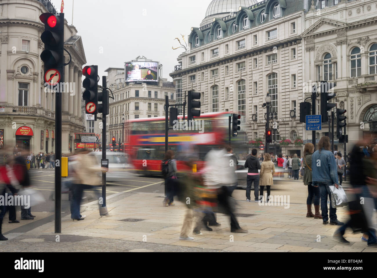Pedestrians and shoppers in Picadilly circus, London, England, UK - Stock Image