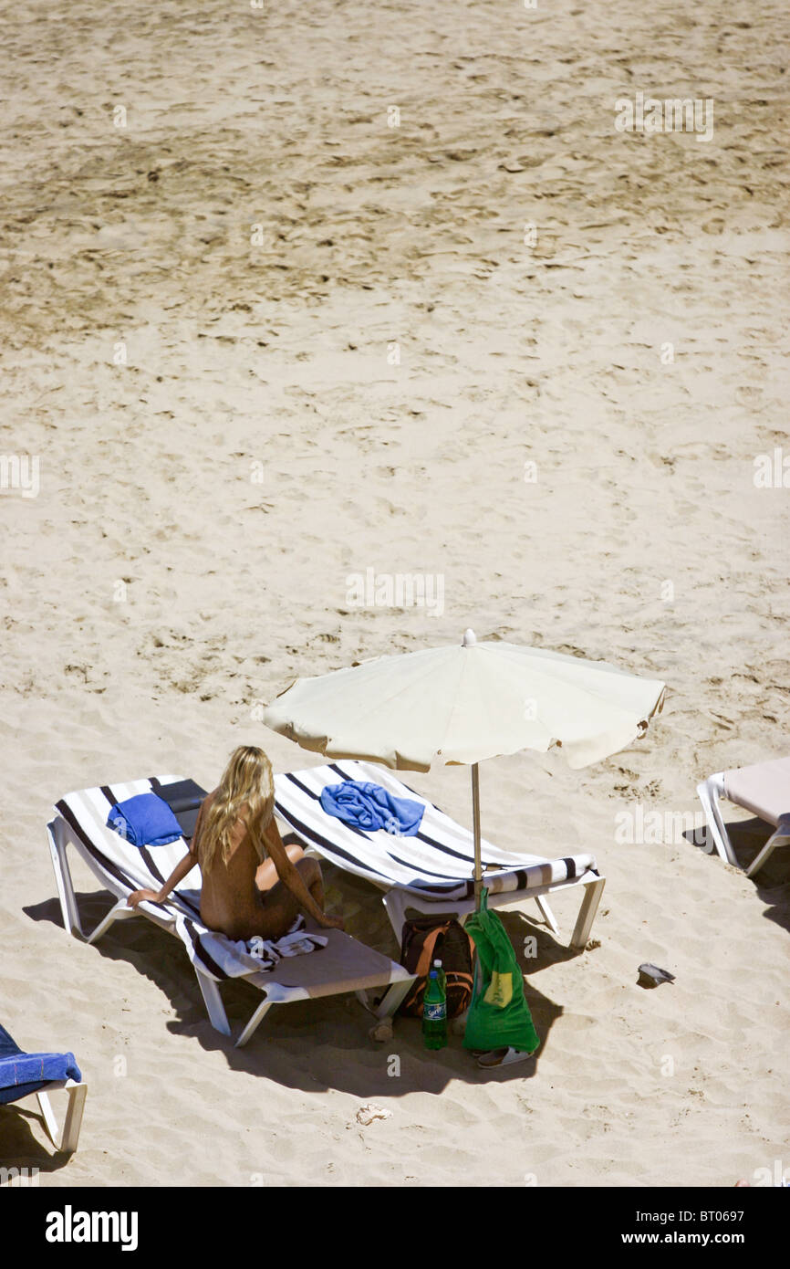 Nude woman relaxing on beach photo 525