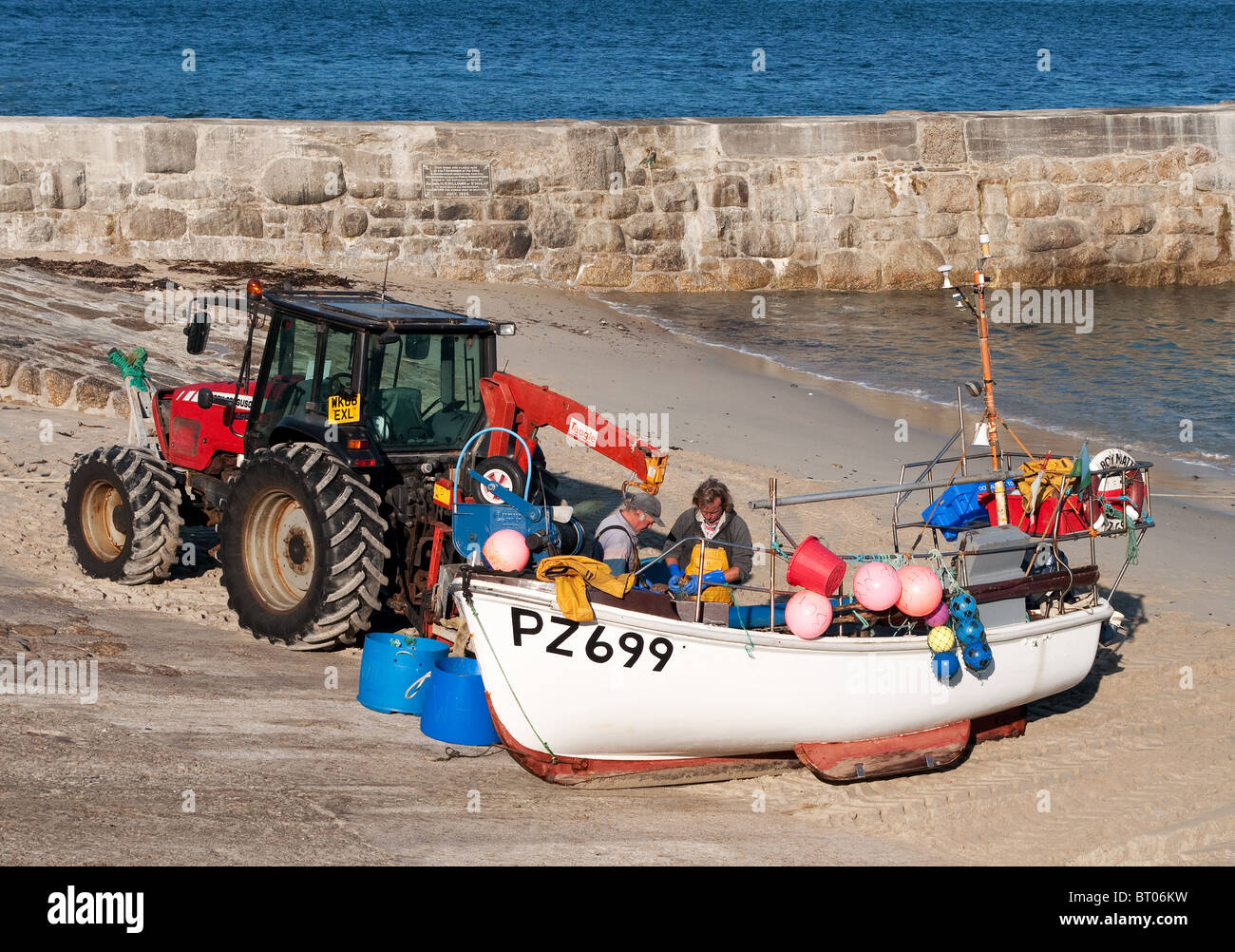 fishermen land their catch at sennen cove in cornwall, uk - Stock Image