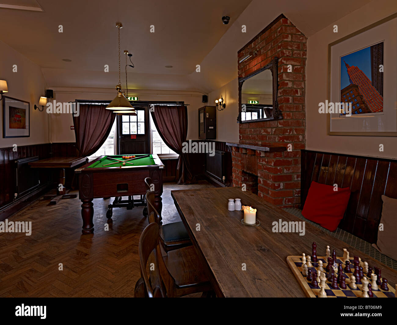 The pool table in the games room of an old english pub or public house in the UK - Stock Image