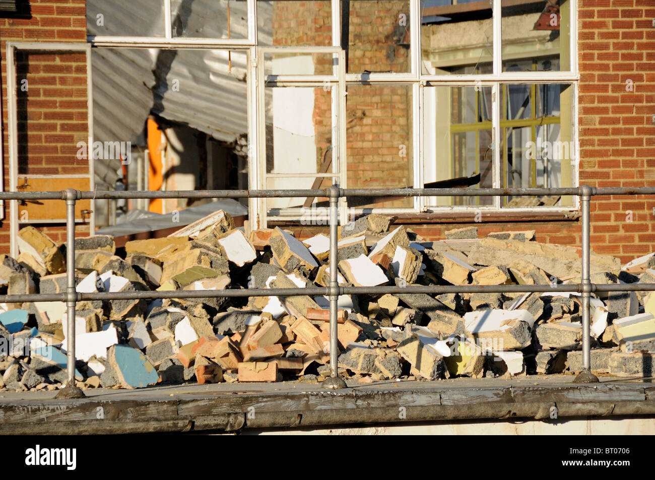 Brick rubble in front of building being demolished - Stock Image