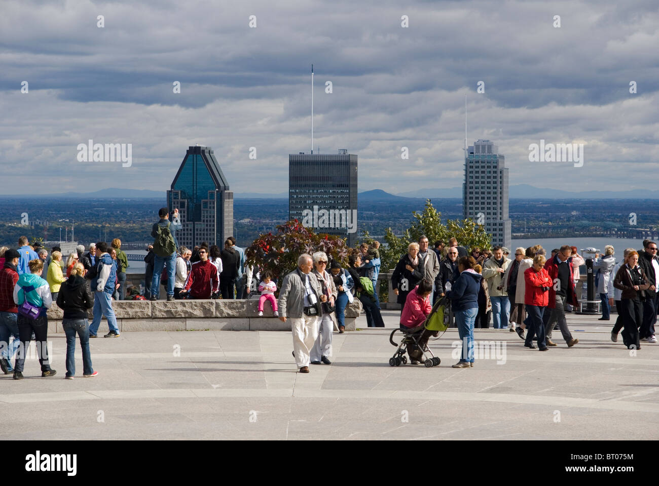 Tourists enjoying the view on the Montreal skyline from the Kondiaronk viewpoint on Mount Royal - Stock Image