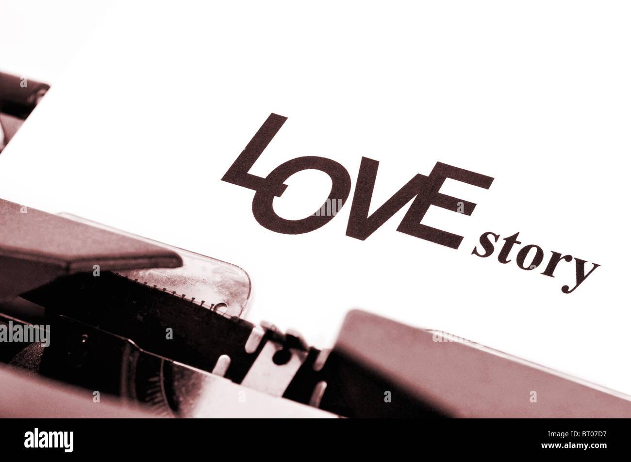 typewriter printed on a white sheet 'love story' - Stock Image