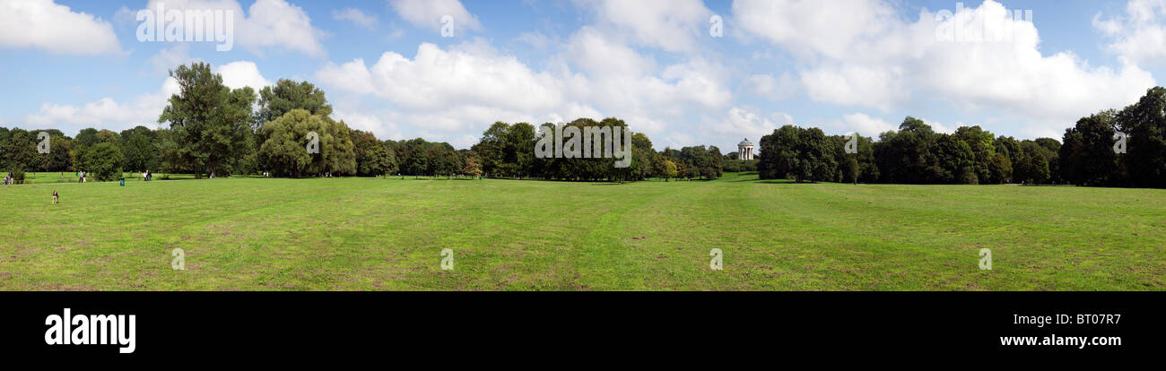 ultra wide panoramic view of Englischer Garten park, Munich - Stock Image