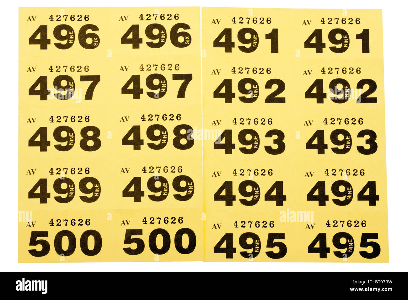 Yellow cloakroom tickets - Stock Image