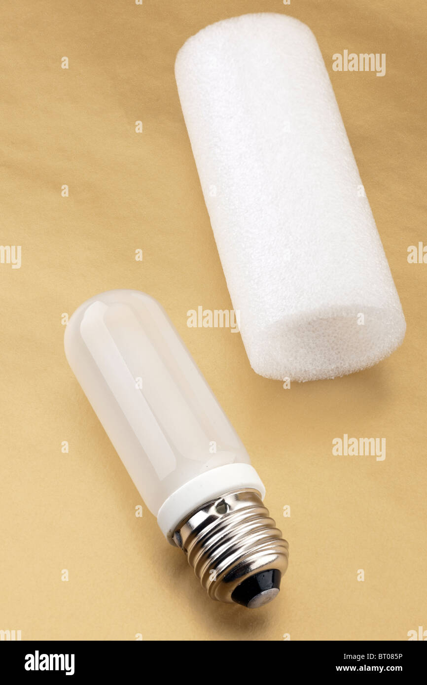 150w replacement modelling bulb from studio flash strobe units with white foam protective sleeve. - Stock Image