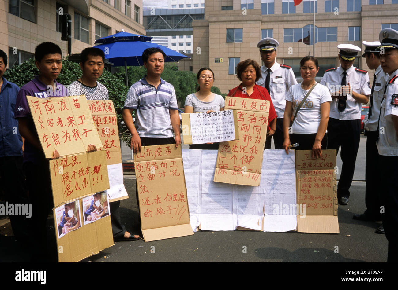 Parents of alleged victims of fake vaccine from Henan, Shandong province protest in front of China's Ministry - Stock Image