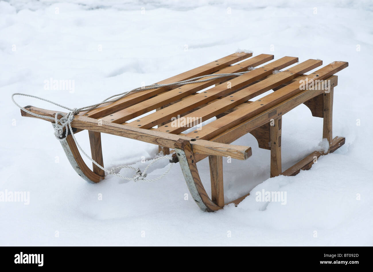 A traditional wooden sledge on snow - Stock Image