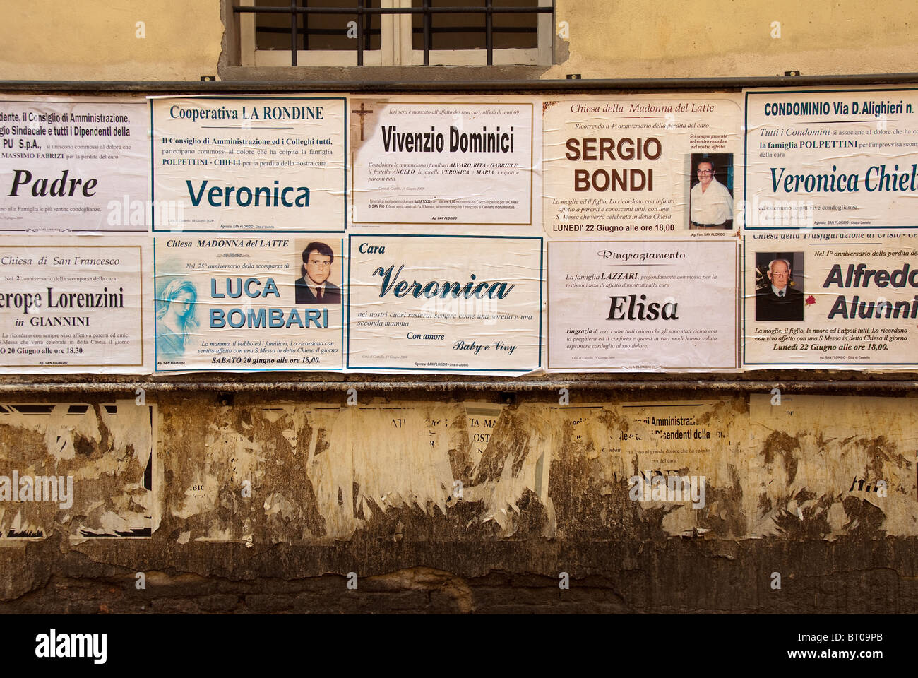 Posters announcing the passing of loved ones in Città di Castello, the major town in northern Umbria, Italy - Stock Image
