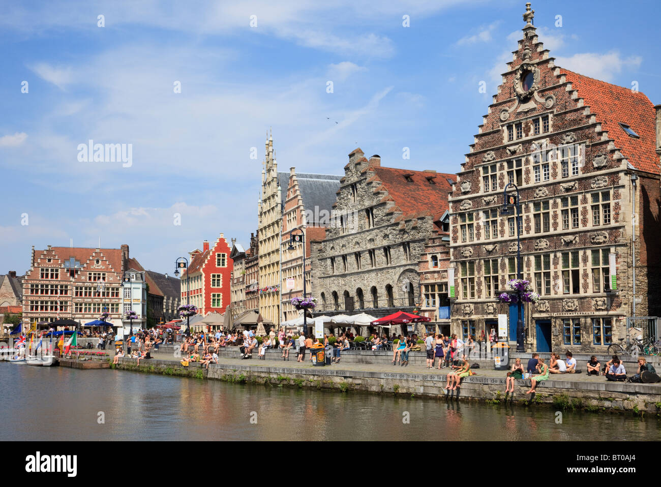 Graslei Site, Ghent, East Flanders, Belgium. River Leie Tussen Bruggen harbour lined with medieval quayside gabbled - Stock Image