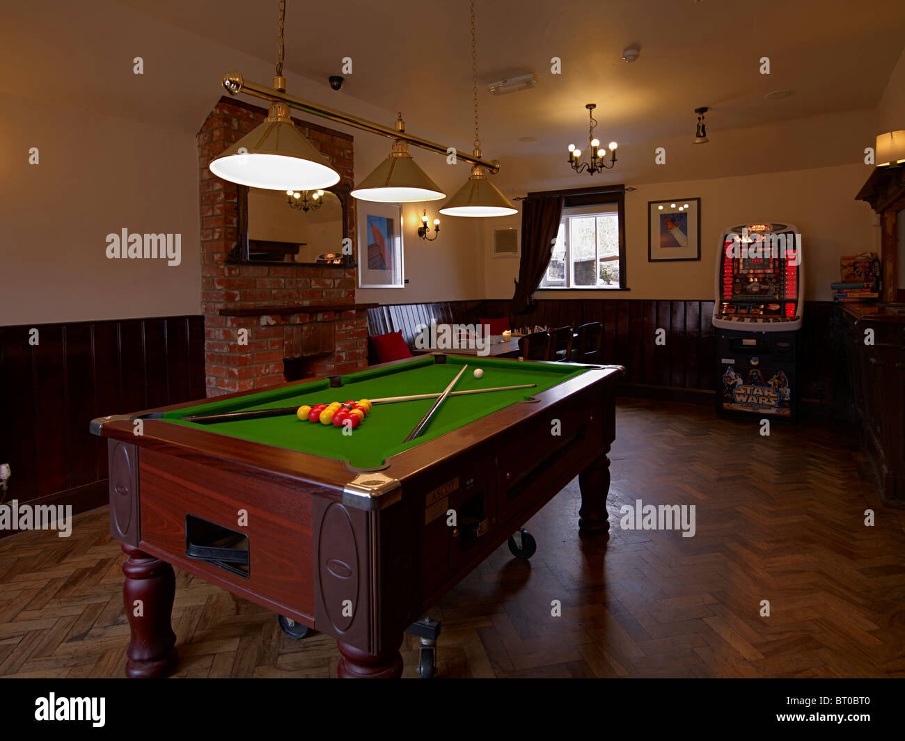 the pool table in the games room of an old english pub or
