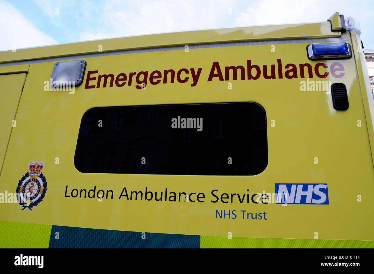 Close-up of a London Emergency Ambulance showing NHS logo outside Smithfield Ambulance Station City of London England - Stock Image