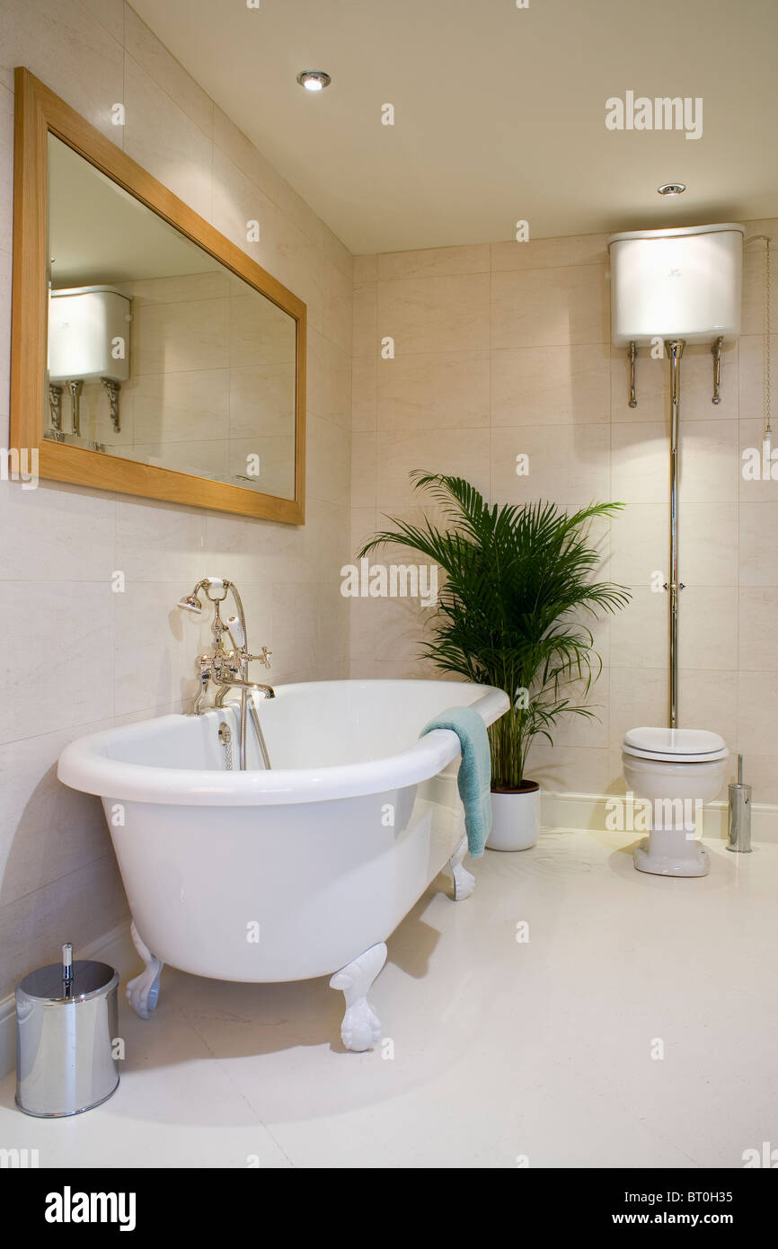 Large Wood Framed Rectangular Mirror Above Roll Top Bath In Cream Stock Photo Alamy