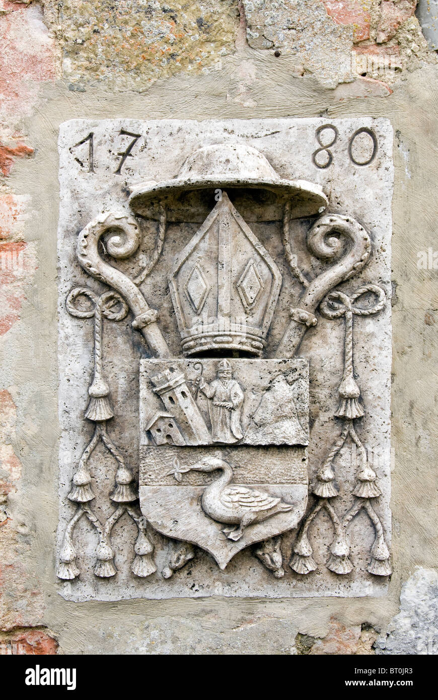 Papal sign in the wall of Canonica a Cerreto - Stock Image