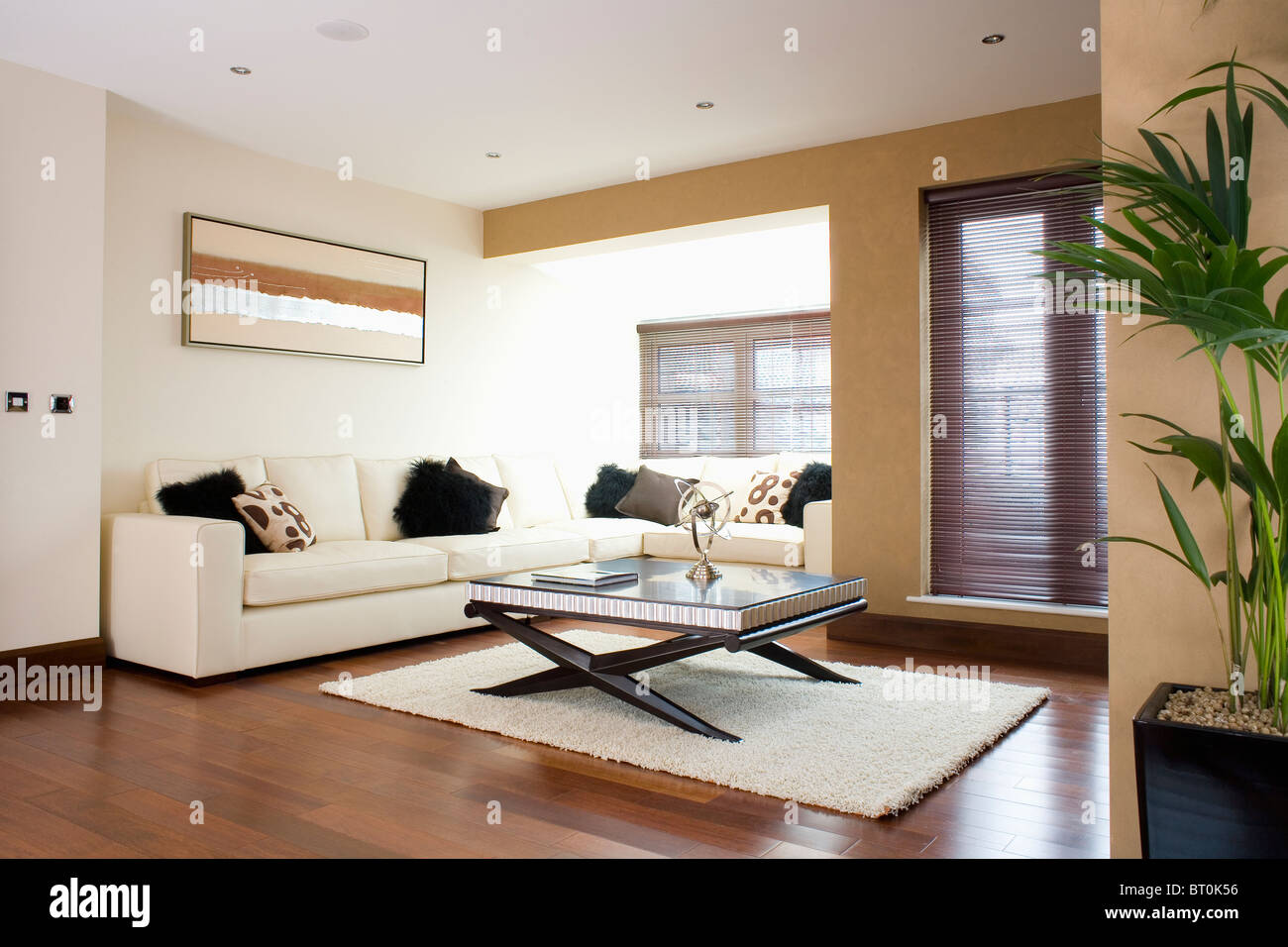Cream corner-sofa in modern apartment living room with coffee-table ...