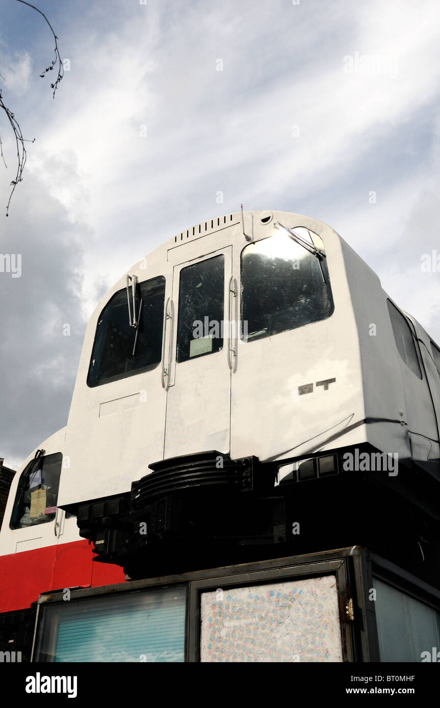 Tube trains against sky, Village Underground, recycled trains used as live and work units Shoreditch London England - Stock Image
