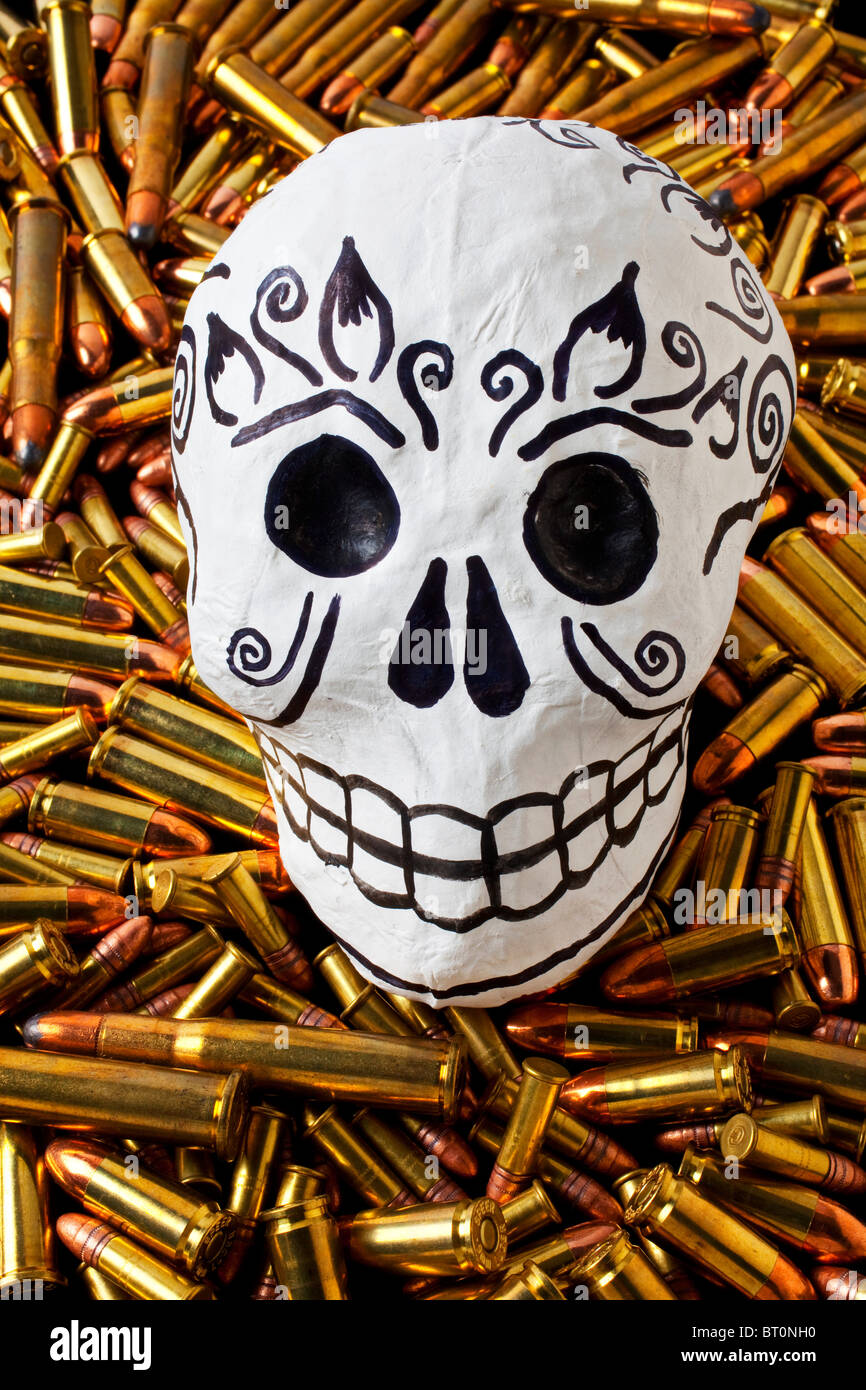 Day of the dead skull on bullets - Stock Image