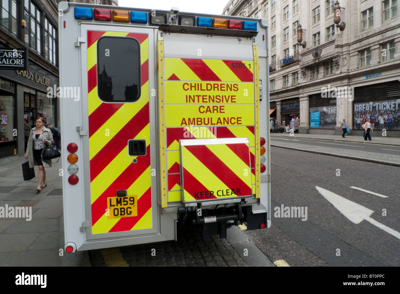 A back view of a Childrens Intensive Care Ambulance, The Strand, London England UK - Stock Image