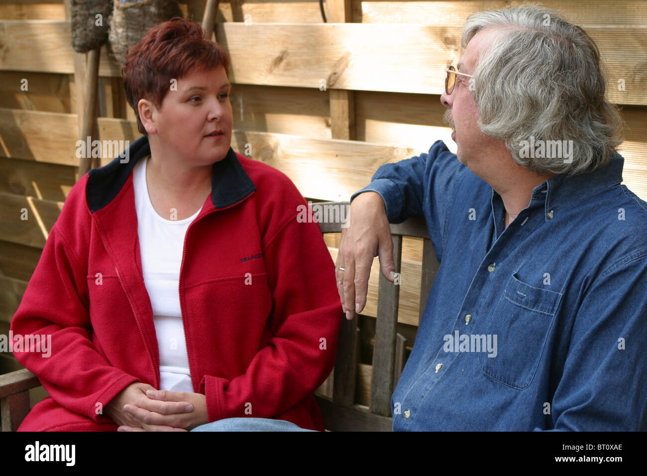 Couple arguing in back yard - Stock Image