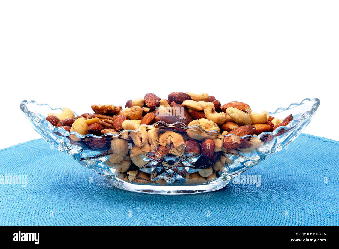 A serving dish full of mixed nuts Stock Photo