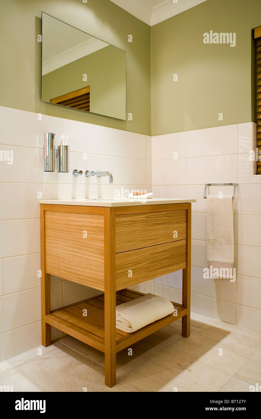 Mirror Above Simple Wood Vanity Unit With Integral Basin In Modern Stock Photo Alamy