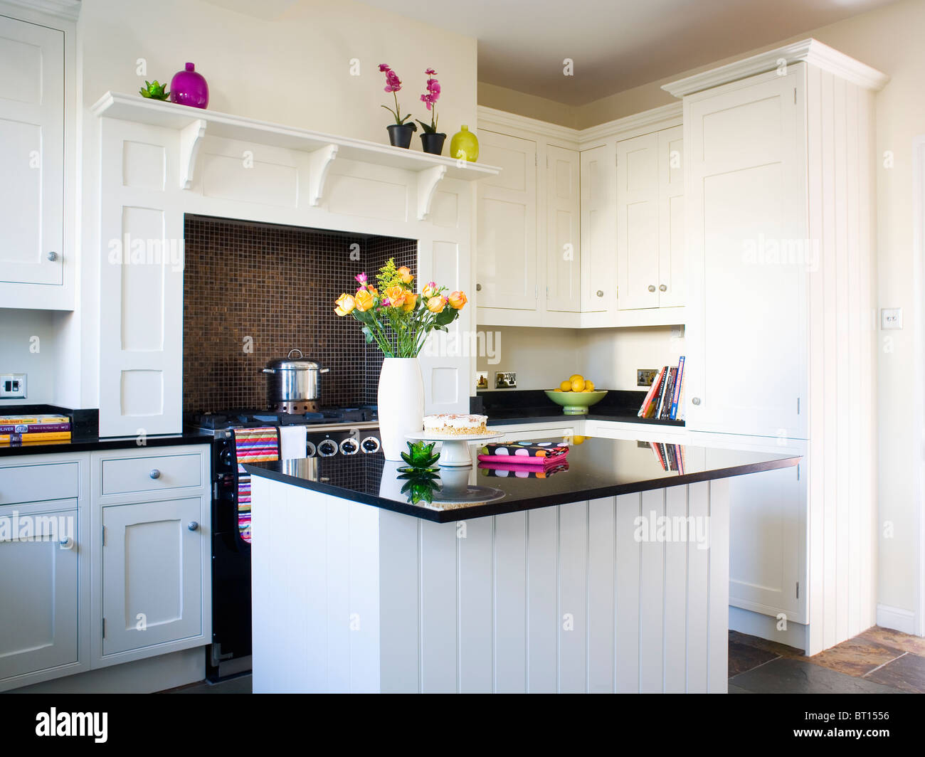 Island Unit With Black Granite Worktop In Traditional White Kitchen Stock Photo Alamy
