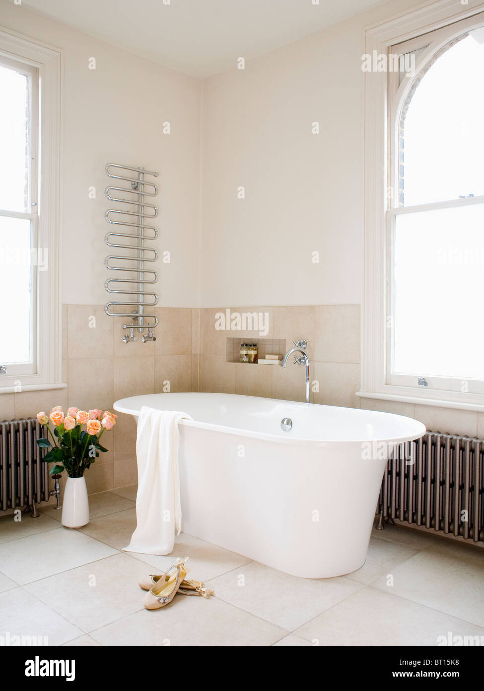 Large modern freestanding bath in modern white bathroom with Stock ...